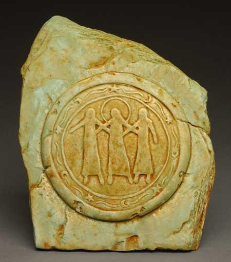 """This plaque was affectionately called """"Sisters."""" In the Irish tradition, the three figures represent Maiden, Mother, and Wise Woman/ Crone. This triad also symbolizes the three phases of the moon: New Moon, Full Moon and Dark Moon. The number three symbolizes creativity, talent and knowledge."""