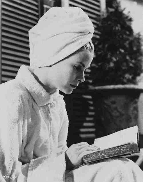 Grace Kelly reading on the set of High Society.