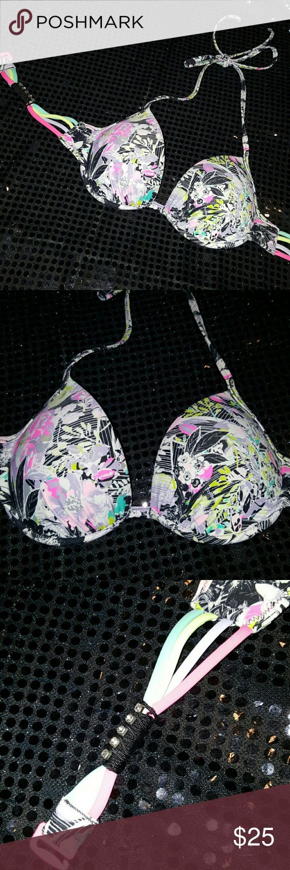2015 Swim halter bikini top 32B Rhinestones Bright colors, only worn a couple times. Tag was cut out because it would pop out. It it a 32B. Gated strap with neon pink hook closure. Lavender seafood neon yellow and hot pink colors accent the black floral print. Super cute. Victoria's Secret Swim Bikinis