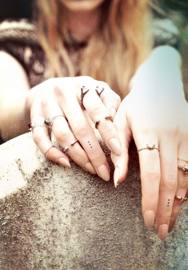 26 Simple And Striking Dotted Finger Tattoos -- they're talking about the tattoo(s), but I'm eyeing the rings.