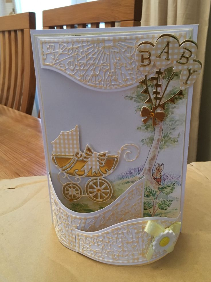 Made by Susan Jewell - New baby card using Tonic window box die , baby carriage and baby balloons dies, Beatrix potter art work gingham card and gold satin mirri card