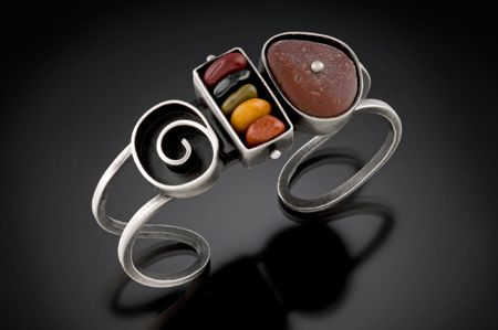 Cuff | Susan Richter-O'Connell. Sterling silver, river rock