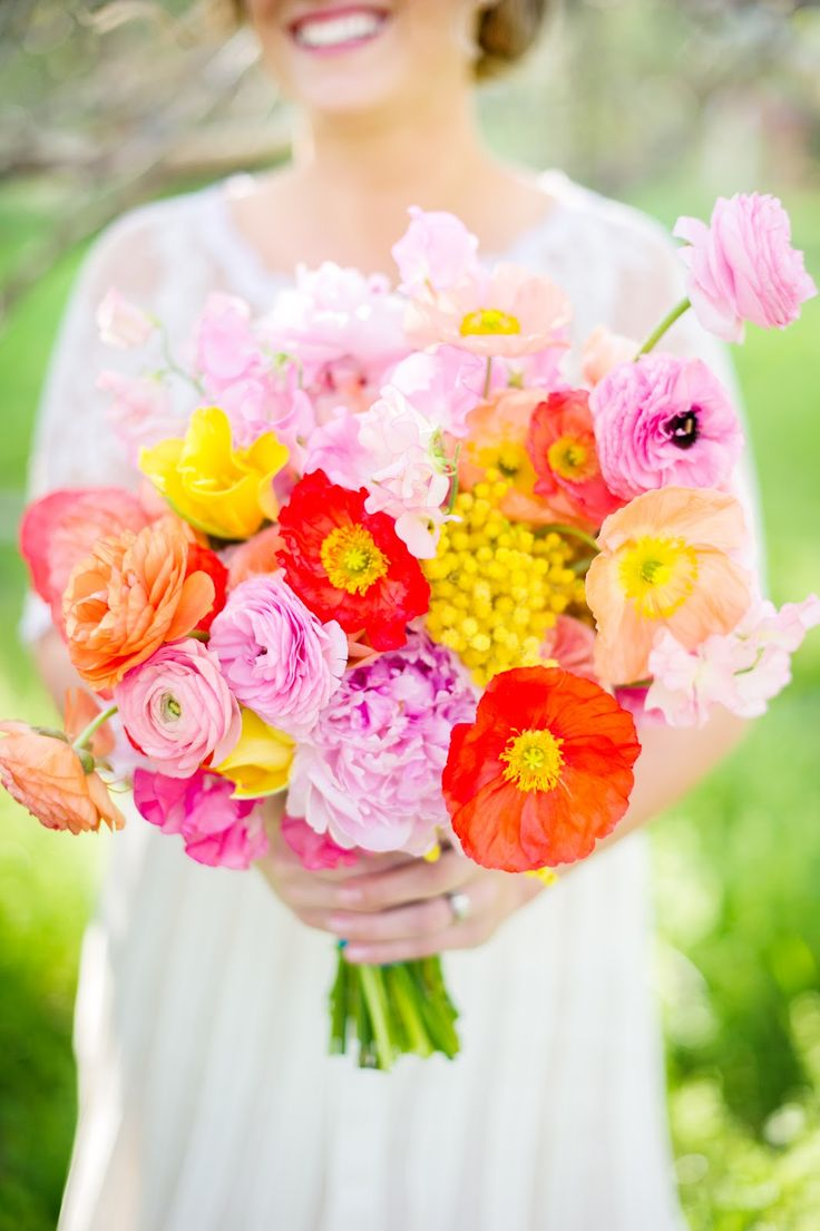 Colorful bouquet of poppies peonies ranunculus mimosa for Bright wedding bouquet