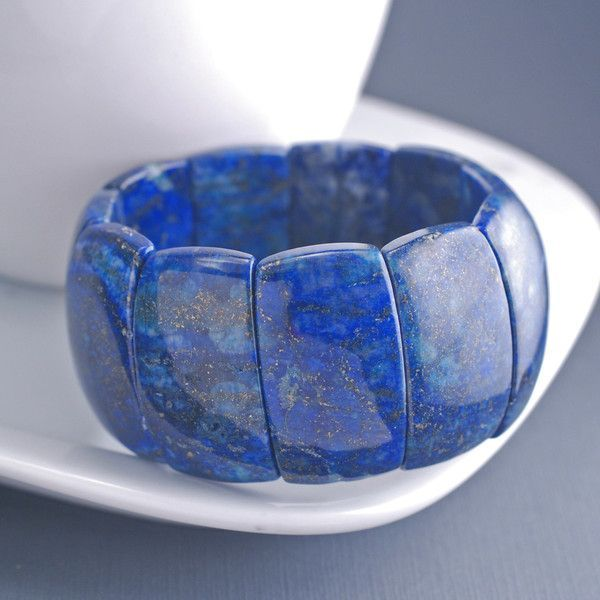 Genuine Lapis stones measuring approximately 1 1/4 inch each and are strung onto…