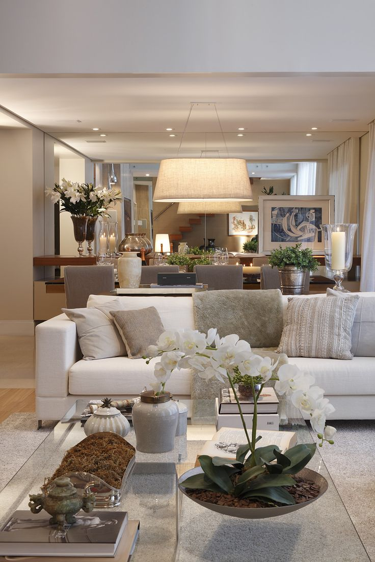 Contemporary interior design & decor in neutral whites - great use of large mirror to increase feeling of space and light.