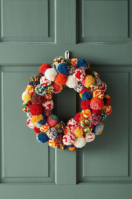 A beautiful Pom Pom Christmas Wreath! A cute DIY idea from #Anthropologie Pom Society Wreath #Christmas #Christmasdecor #Christmastree