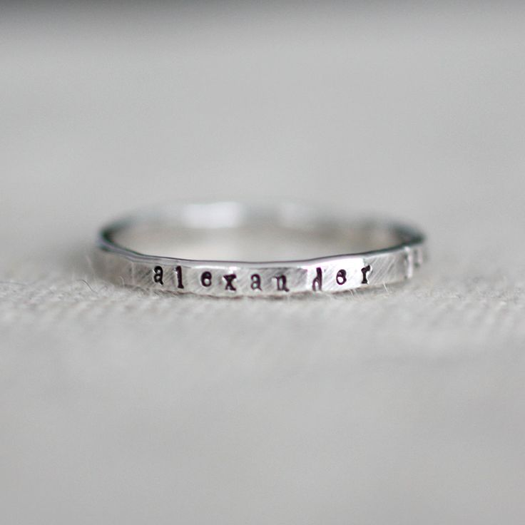 These teeny stacking bands measure approximately 2mm in size and the tiny font is just 1mm in size. The band is hammered and text is darkened to make it easier to see the letters. This font is tiny but it is readable. Perfect for stacking multiple rings to celebrate everyone in your family.  Please note that the gold filled and rose gold filled will have a slight yellow gold seam on the bottom of the ring. See the pictures for more information on the yellow gold seam. Metals: sterling ...