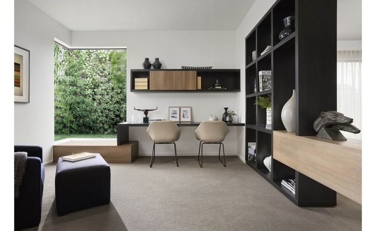 Coco Republic Interior Design creates a spacious, modern study with dark cabinetry, high end furnishings and minimalist style features such as a bold corner window. #CocoRepublic #InteriorDesign #workspace #inspiration #home #design