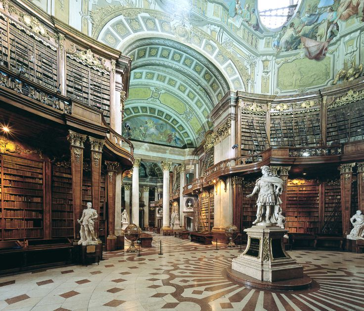 Minerva, the Roman goddess of wisdom, stands guard over this commanding baroque library, dating from 1723.