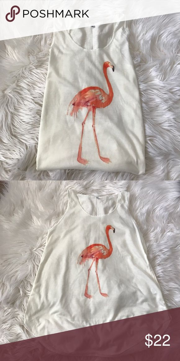Pretty Flamingo on a Tank Pretty Flamingo on a Tank.  An addition to my graphic tank tops.  Adorable flamingo on an ivory tank top.  Versatile, chic and cozy.  Wear as a lounge top, dress up with a chic vest or blazer for an edgy look or even wear as a yoga tank. Tops Tank Tops