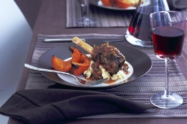 Slow-roasted lamb shanks with tomatoes and lentils main image