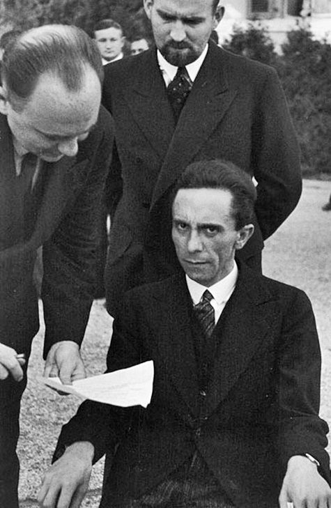 Joseph Goebbels scowling at photographer Alfred Eisenstaedt after finding out he's jewish, ca. 1933