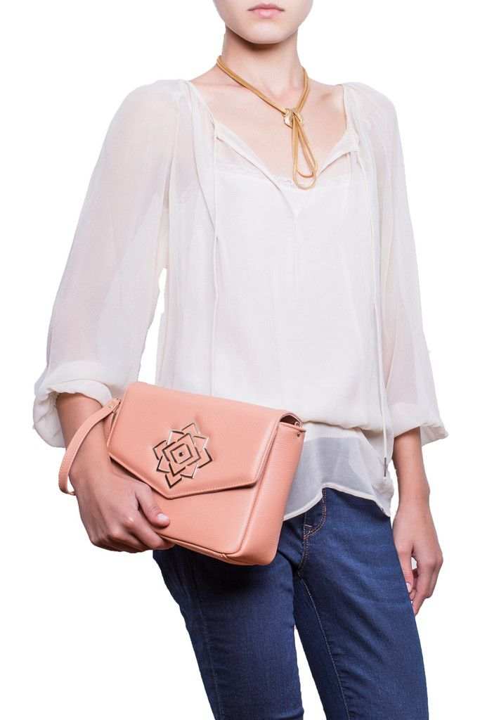 Keep your cool with the Rose Story easy-going leather handcrafted crossbody bag. Whether using it for workdays or weekends, the design's eye-catching pattern and polished light-gold tone hardware will keep your style on point. #busta #bustabags #leatherbag #leather #streetstyle #palepink #pink #rose #handmade #crossbody #leathercrossbody #bag #metalchain #chain #metal