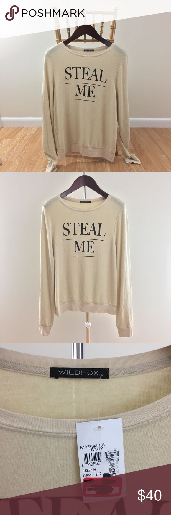Wildfox Steal Me Sweater NTW. Material is fuzzy. Its normal for wildfox items to do this. There is a dark spot near the armpit. I did a close up. I do not know if this will come out with washing.   No trades or holds. Wildfox Sweaters Crew & Scoop Necks
