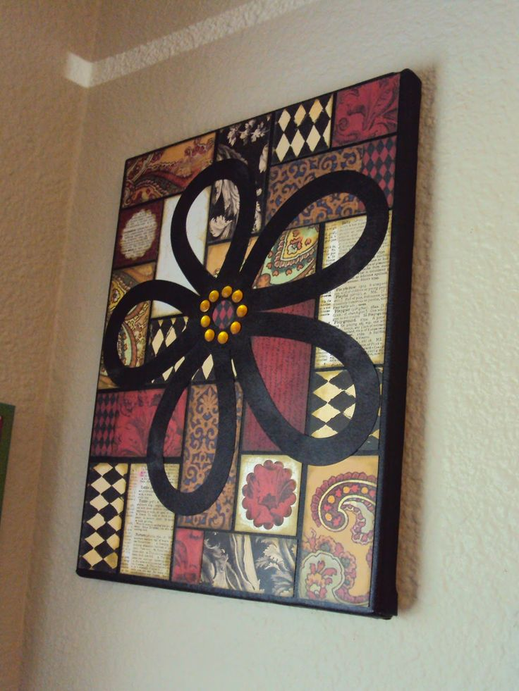 Canvas Idea using scrapbook paper - Interesting... Only instead of a flower i would make a peace sign.