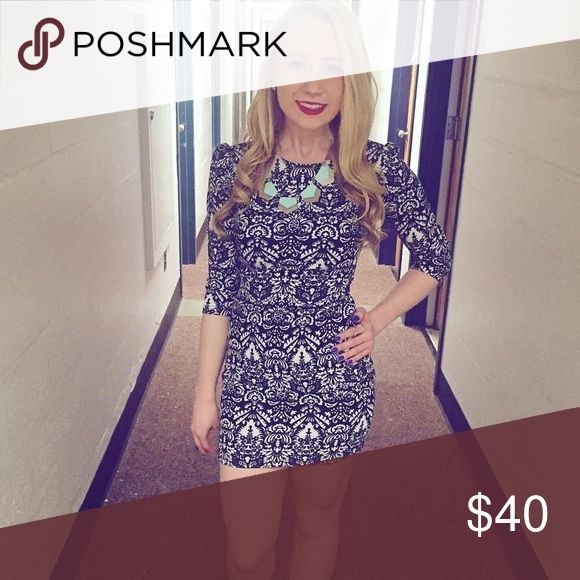 Blue and White patterned Bodycon Stunning blue and white Bodycon dress with three quarter sleeves and perfect length for a formal. I got so many compliments on this dress but it unfortunately doesn't fit anymore so it's onto the next home! Only worn twice Dresses Mini