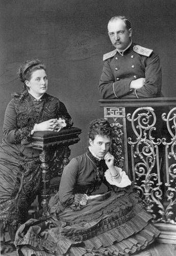Olga Constantinovna (left) with her husband King George I of Greece and his sister Maria Feodorovna, Tsarevna of Russia (in front)  (I think, but she also looks like Alexandra)
