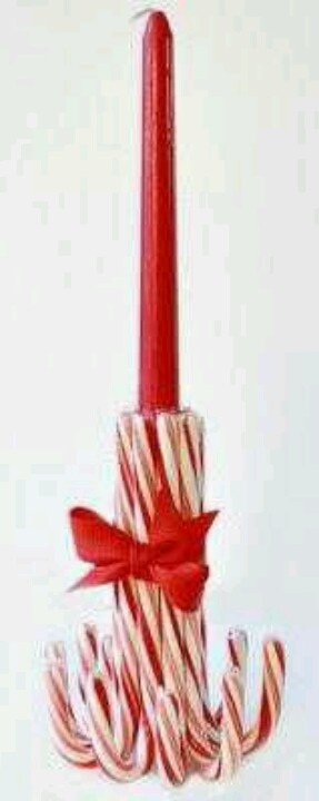 Taper candle holder from candy canes