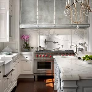 gorgeous white marble kitchen but the star the show is the stove many wonderful parties will be happy here...and the designer Mr O'Brien did a fantastic job