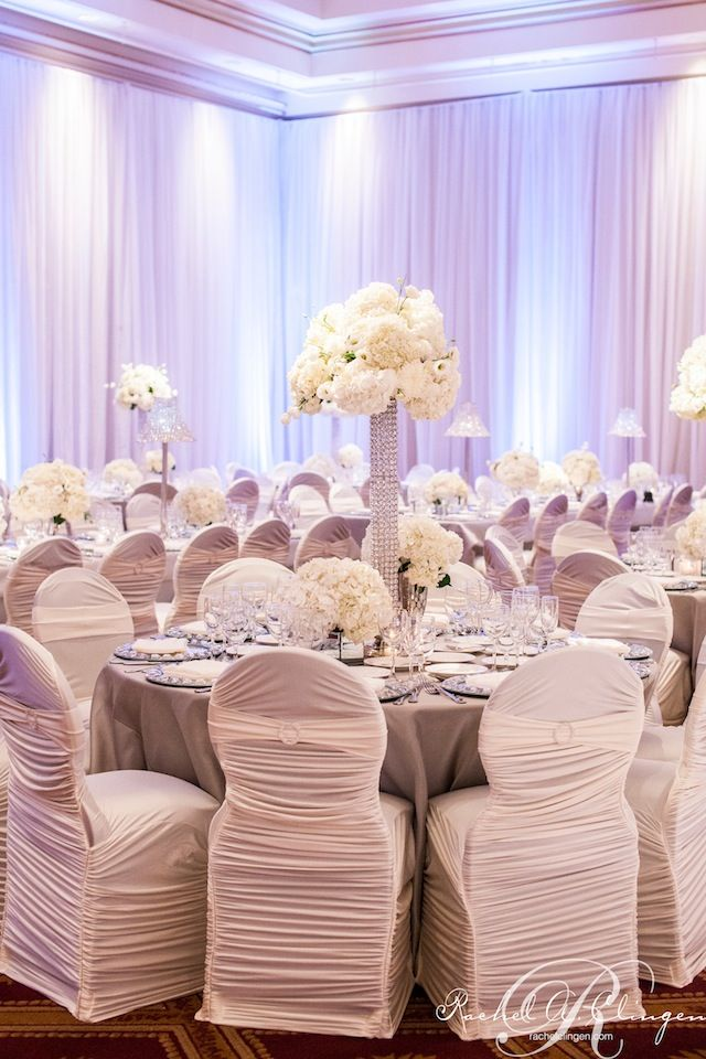 White floral centrepieces on our crystal towers  photo credit @Rowell Photography