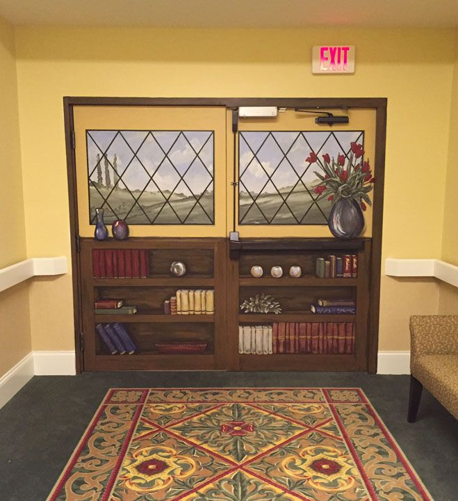 Window/Bookcase mural on a set of double doors leading into a Memory Care Unit at a local nursing home facility