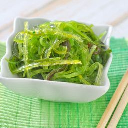 Goma Wakame (Seaweed Salad)  2 cups Wakame Stems 3 tablespoons Vinegar; Rice, or White, can use Apple 1 1/2 tablespoons Sugar; Can replace with Stevia/splenda 1 - 2 tablespoons Soy sauce; Can use Wheat free Tamari 1/2 teaspoon Sesame Oil; Either toasted or regular Red chile; To taste Sesame seeds; Garnish 1 teaspoon Ginger; Optional 1 teaspoon Garlic; Optional Original recipe makes 1 Servings
