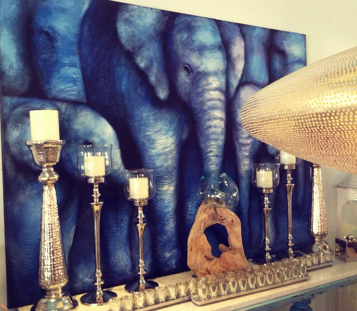3D Elegant hand painting with five blue elephants.