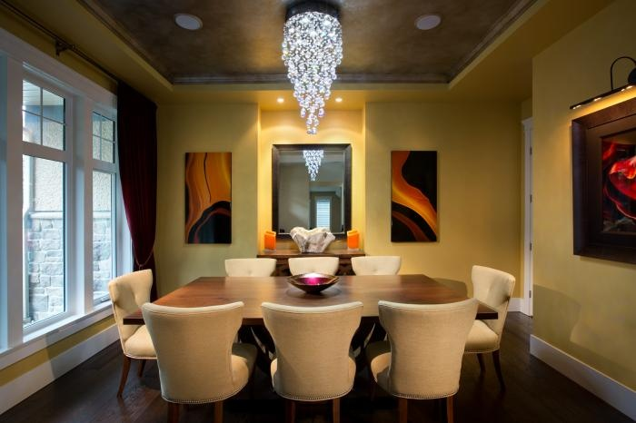 Stunning dining room design has great warm colors.