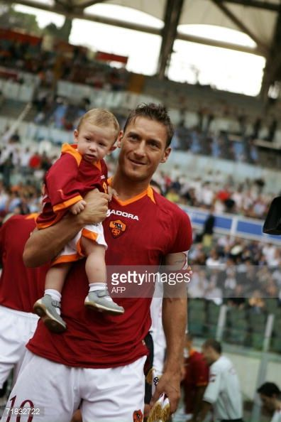 AS Roma's captain Francesco Totti holds his son Cristian before AS Roma vs Livorno Serie A football match at Olympic Stadium in Rome 09 September...