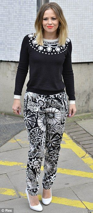Monochrome chic: Kimberley looked chic in a pair of patterned trousers, embellished jumper and white heels