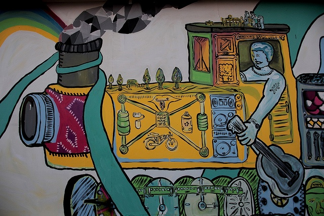 Valparaiso - el cerro graffiti. Valparaíso has also expanded beyond its historic livelihood and culture, and this is abundantly evident when you move beyond the hard-scrabble sea-level streets. The city is laid across an amphitheater of hills all focusing towards the half-moon bay that doubles as its port. Hilly urban landscapes always seem to engender charm and character — monotony of cityscape