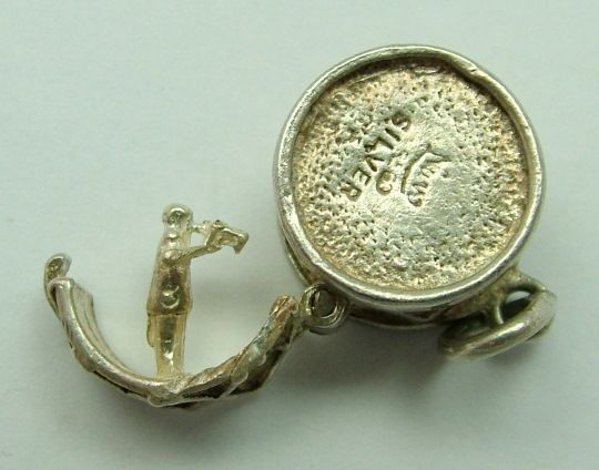 1960s English silver Nuvo charm of a drum that opens to reveal a man playing the trumpet inside-  28gp