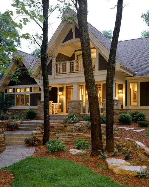 Master balcony uptop! Gorgeous front porch and yard! Neat home with great white beams and paint color.