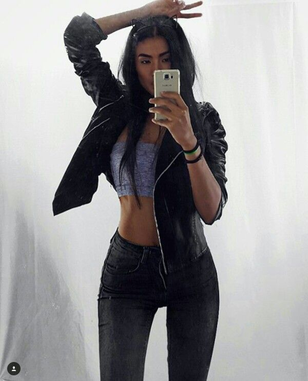 Love her outfit - black jeans, black leather jacket and a bandeau