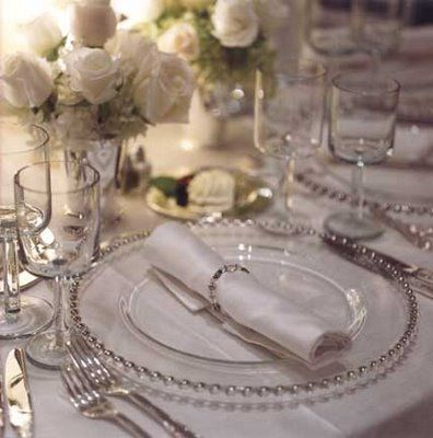 We like the ROLLED napkin, the white flowers.  How would all this look on a blue table cloth with blue napkins and using silver charger and white plates? Also, how would rolled napkin tied with organza ribbon and one flower look?
