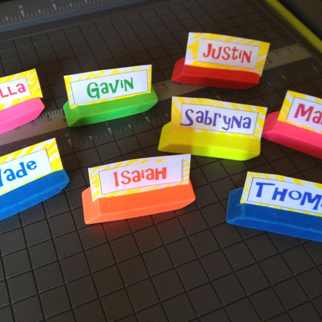 Eraser name cards  I bought the erasers from Dollar Tree. I cut a slit across the top for the name plates. Super easy! These will be on my students desks for the first day of school!