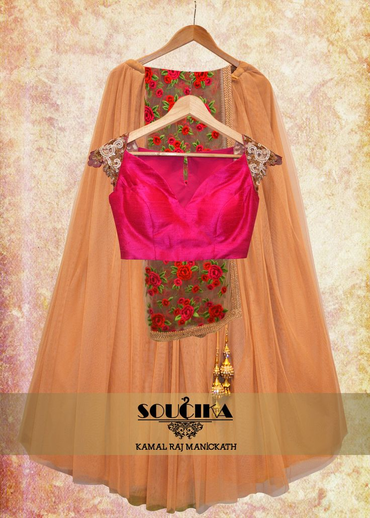 Beige net skirt with pink raw silk blouse and lace dupatta, only from Soucika by Kamal Raj Manickath. To order or enquire, Contact us at 080 41637631, 080 25505553, 080 41115006, or write to us at info@soucika.com. #soucika #kamalrajmanickath #ethnic #lehenga #blouse #pink and #beige #femmefatale