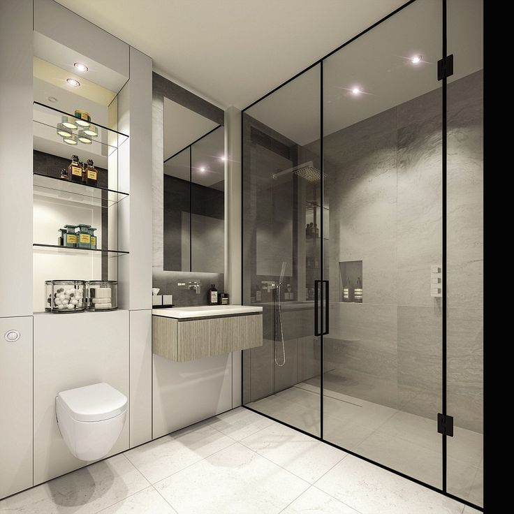 The bathrooms are set to include large walk-in showers with bronze tinted nickel framed shower screens.