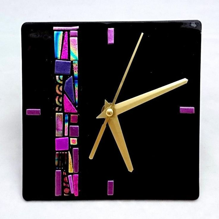 All fused glass clocks are 100�0HANDMADE in Australia by Glass Obsessions.Each clock has a mosaic strip of dichroic glass completed entirely by hand. This ensures that no two pieces will ever be the same! These clocks are made with black Spectrum glass and CBS dichroic glass. Dichroic Glass is a special type of glass that contains many thin layers of metal oxides. This allows the glass the glitter and shine different colours depending on the angle of light.Dichroic Clock...