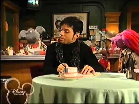 """Prince seems right home in this episode of the Muppets Tonight TV show which aired in 1997.  Things get positively psychedelic as the Purple One sings """"Starfish And Coffee"""" and """"She Gave Her Angels."""""""