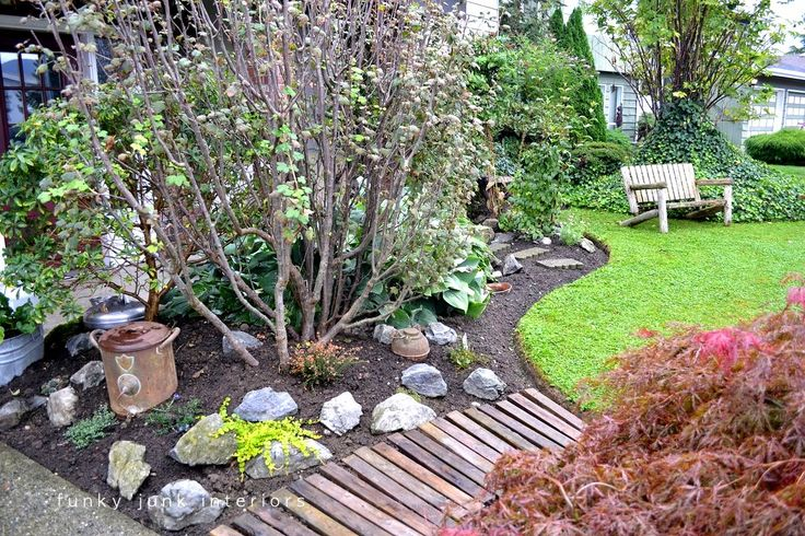 Creating a pallet wood garden walkway is easy and cheap! The secret to this walkway is using pallet or crate boards with a little more depth for water run off.