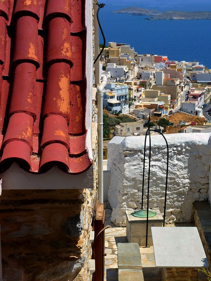 Red tiled roof and seascape. Ano Syros, Syros island, Cyclades, Greece