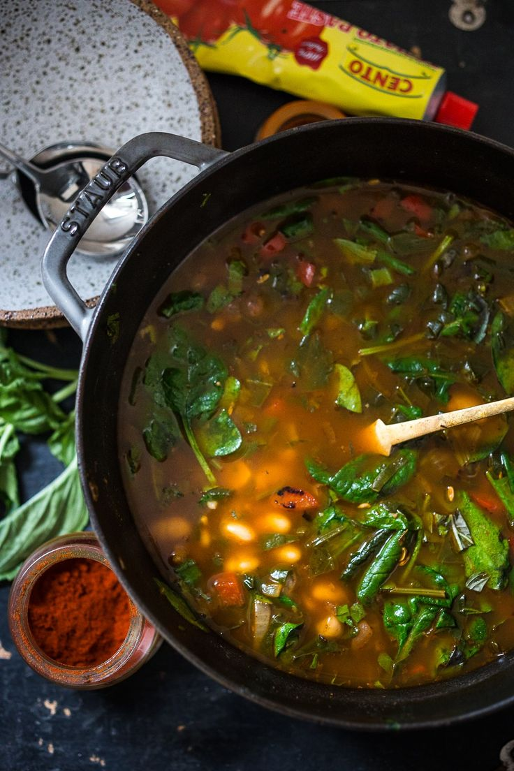 """Smokey Tomato Detox Broth- a healing detoxing pot of soup- with beans, vegan """"meat balls"""", spinach, pasta, or make it your own. Nutritious and cleansing. Vegan, Gluten Free. 