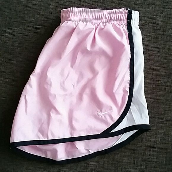 Nike Dri Fit Shorts Nike Dri Fit shorts in light pink with white/black side stripe accent. Built in liner. Body and liner 100% polyester. Kids size L, fits like Ladies S. Nike Shorts