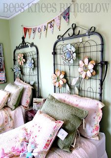 Clever, cute and creative...fence gates as headboards.  If put together these could make a headboard for a double bed.  This entire room has great ideas.  I like how wire fencing has been used.  I think this would be a fun garden cottage guest room.  Bees Knees Bungalow, it's worth a look.