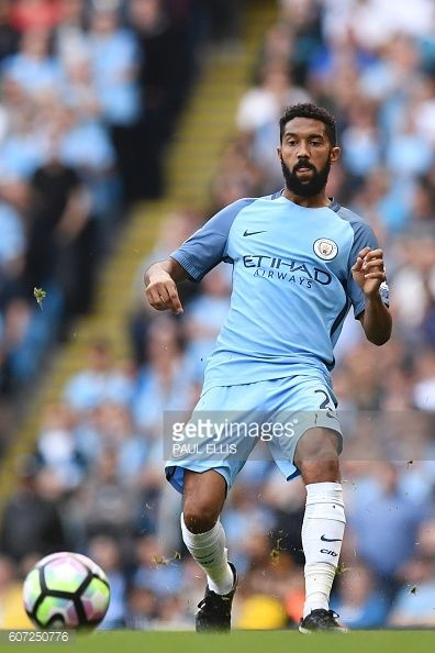 Manchester City's French defender Gael Clichy passes the ball during the English Premier League football match between Manchester City and...