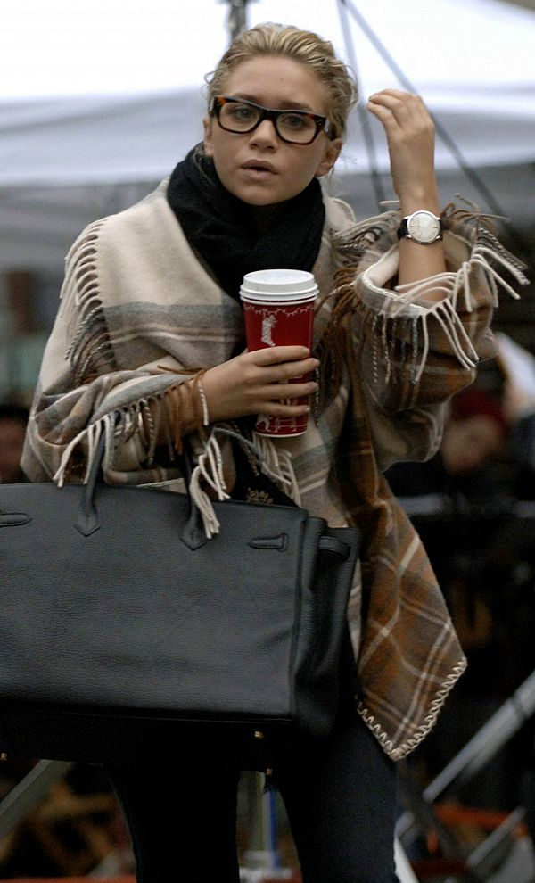 ashley olsen- digging the scarf blanket poncho. i need.
