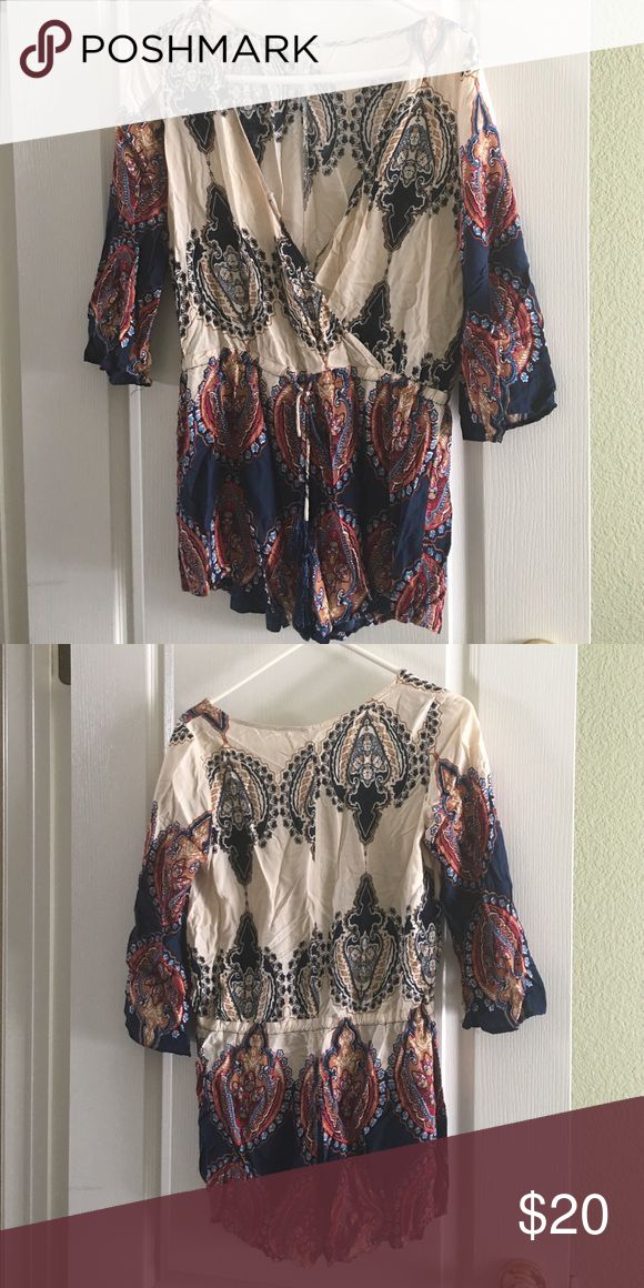 Plunge neckline romper Romper with plunge neckline. Tie at waist. 3/4 sleeves. Perfect for festivals or weekend out! Other