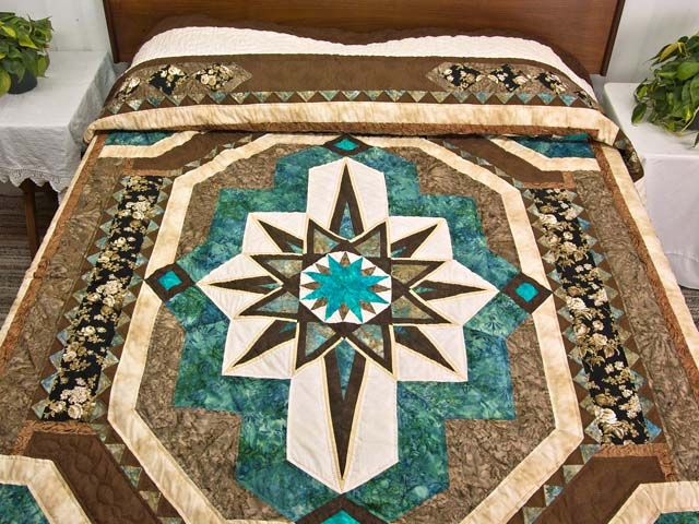 Turquoise Brown and Tan Medallion Star Quilt ... WOW  its gorgeous!! I would make a few changes though...