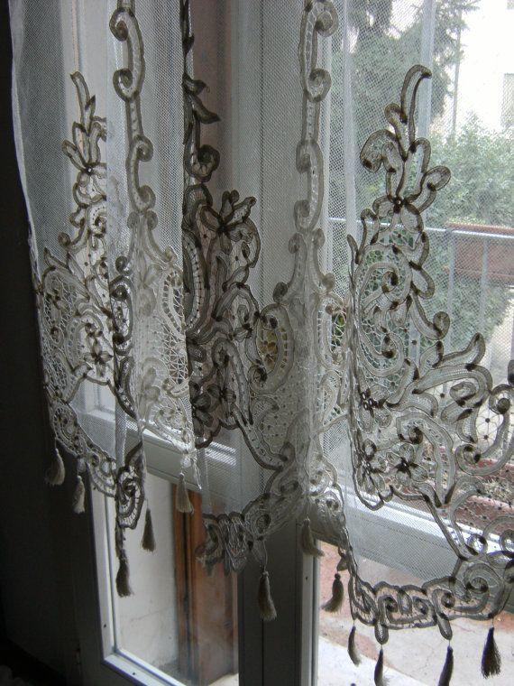 The object of my lust was found during my travels of the European countryside years ago.  I fell in love with undulating fine lace in the cottage windows with bright floral window boxes.  I couldn't bring the flowers home, but the fine lace...well then, they will find a home in my dining room window, layered with billowing, pooling satin drapery.